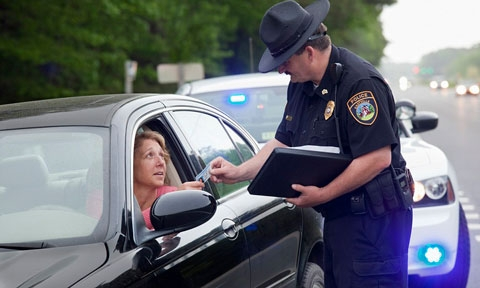 police office giving a ticket